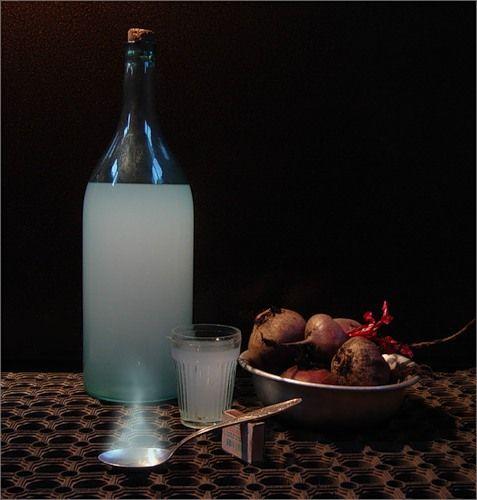 Бутылка самогона на столе